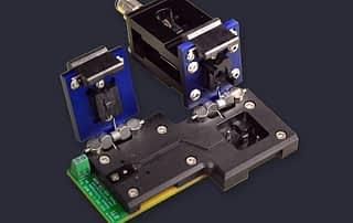 Custom dual stage clamshell socket for flex PCB DUT includes pneumatics