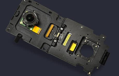 Custom rigid-flex clamshell style socket with access to lens