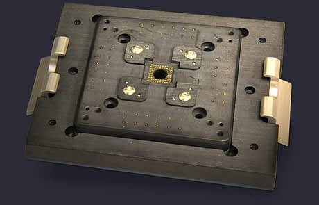 PCB in lid translates signals from contacts on top of DUT