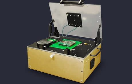 RF shielded test fixture box with PCB UUT and driver components